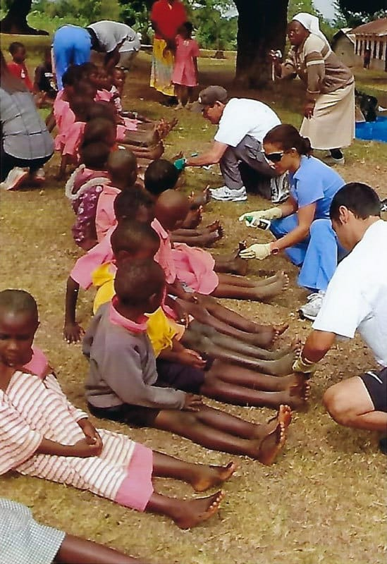 Volunteers treat students for feet infections